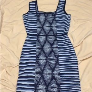 Turn heads in this blue multi patterned dress!